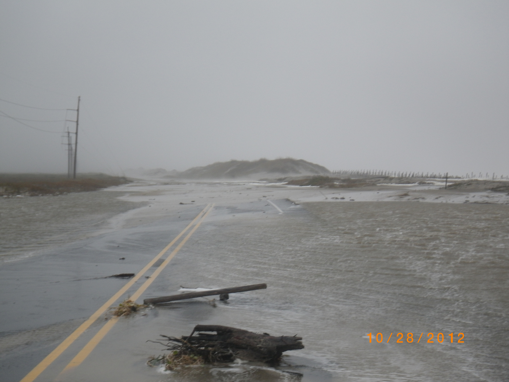 Road covered in water and debris